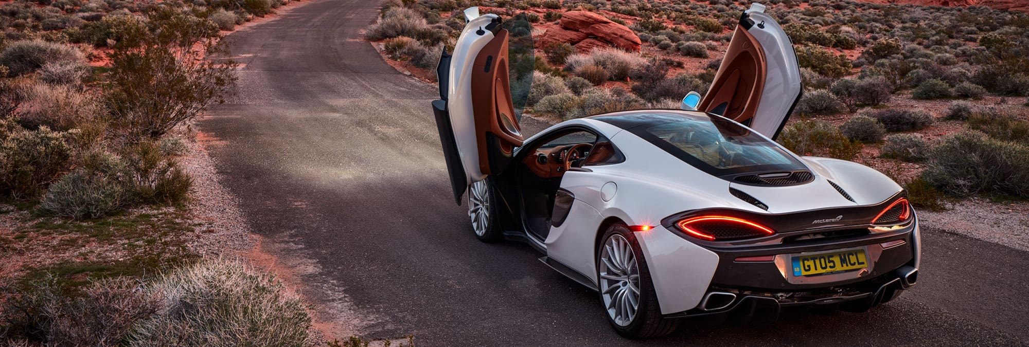 mclaren-570gt-white-for-sale-rear-3quarter-doors-up-hero